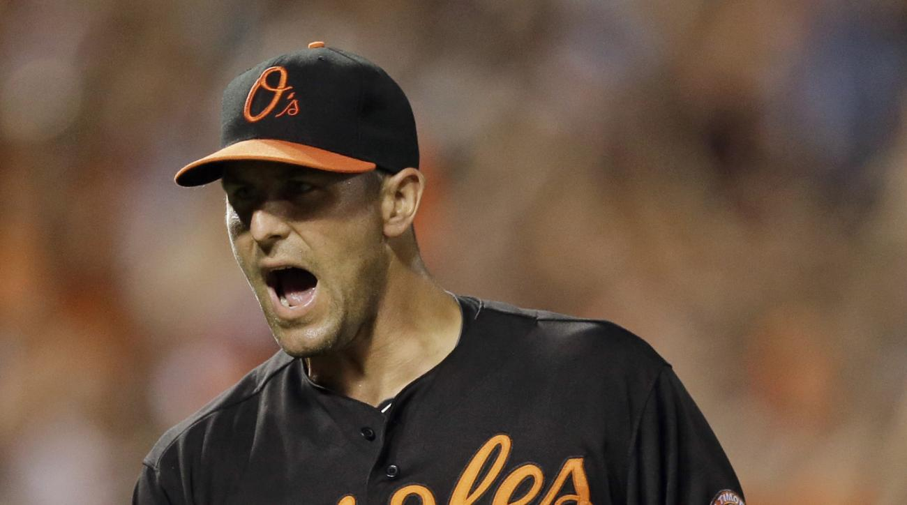 FILE - In this May 29, 2015, file photo, Baltimore Orioles relief pitcher Darren O'Day reacts after ending the ninth inning of a baseball game against the Tampa Bay Rays in Baltimore. In his four years with Baltimore, O'Day has put up impressive numbers.