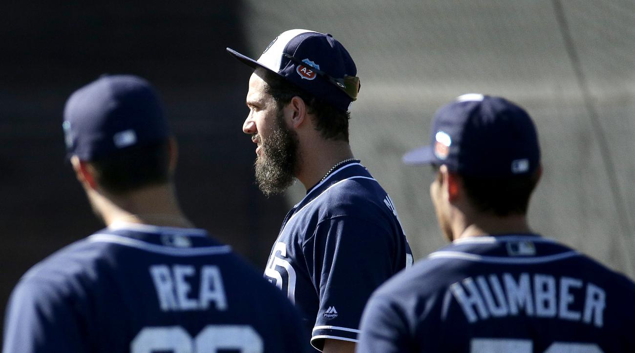 San Diego Padres pitcher James Shields, center, instructs fellow pitchers during spring training baseball practice Monday, Feb. 22, 2016, in Peoria, Ariz. (AP Photo/Charlie Riedel)