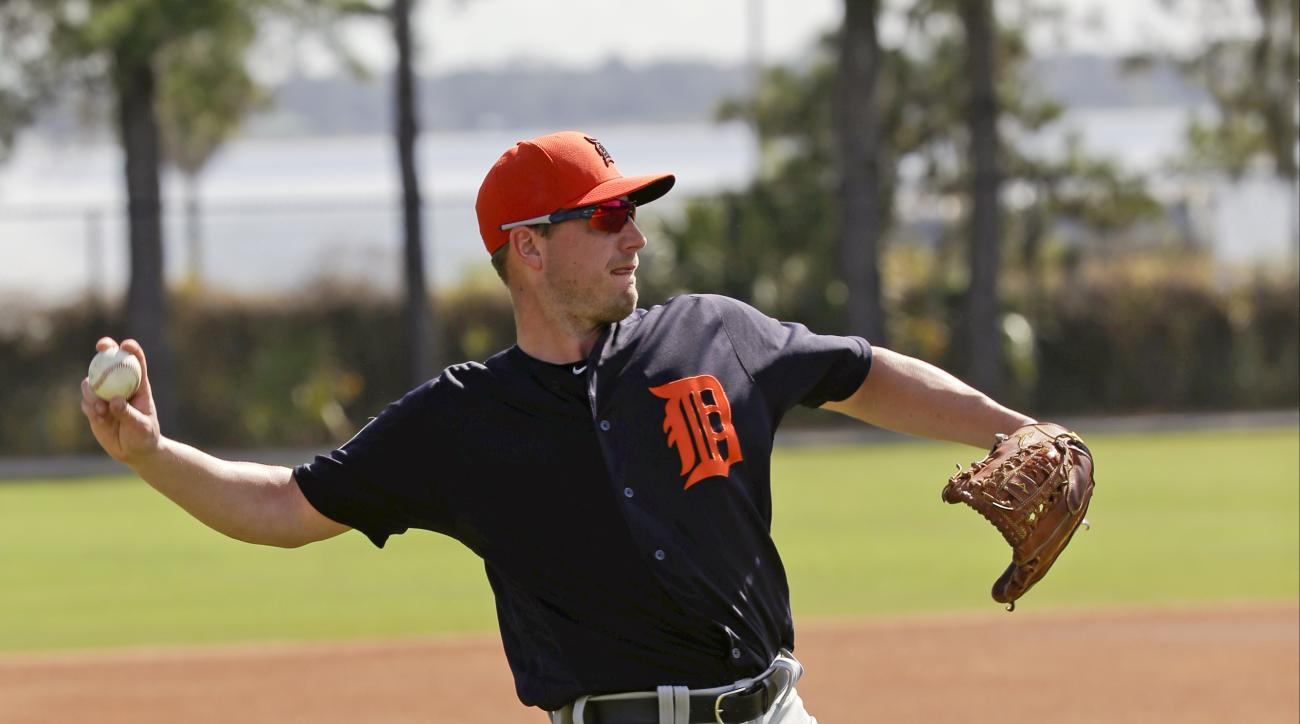 Detroit Tigers starting pitcher Jordan Zimmermann throws to first base during a drill at a spring training baseball workout, Monday, Feb. 22, 2016, in Lakeland, Fla. (AP Photo/John Raoux)