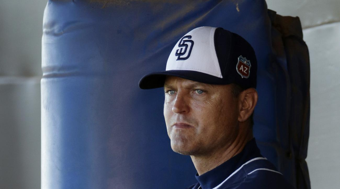 Former San Diego Padres closer Trevor Hoffman watches pitchers throw during spring training baseball practice Monday, Feb. 22, 2016, in Peoria, Ariz. (AP Photo/Charlie Riedel)