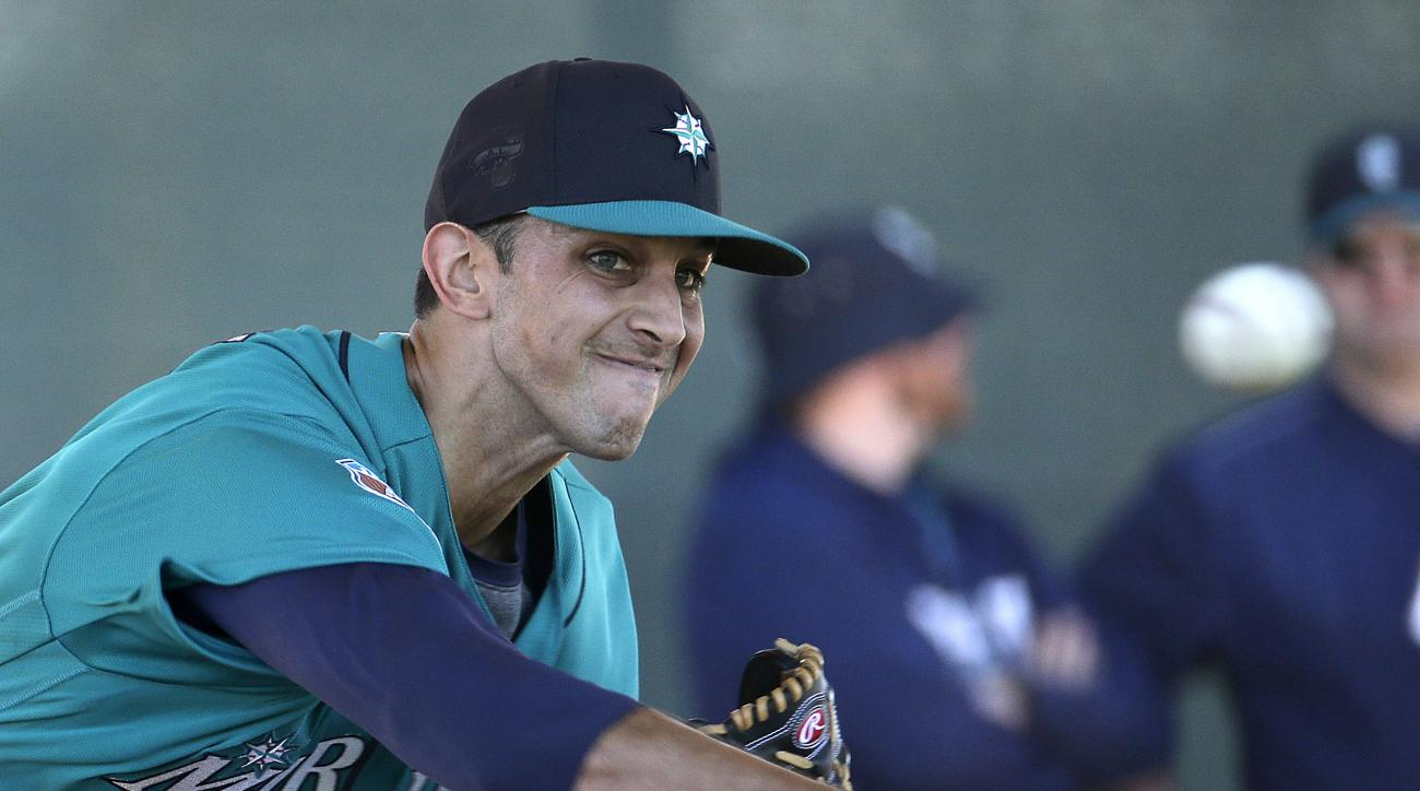 FILE - In this Feb. 20, 2016, file photo, Seattle Mariners pitcher Steve Cishek throws during spring training baseball practice, in Peoria, Ariz. There may not be a more important offseason signing for the Seattle Mariners than relief pitcher Steve Cishek