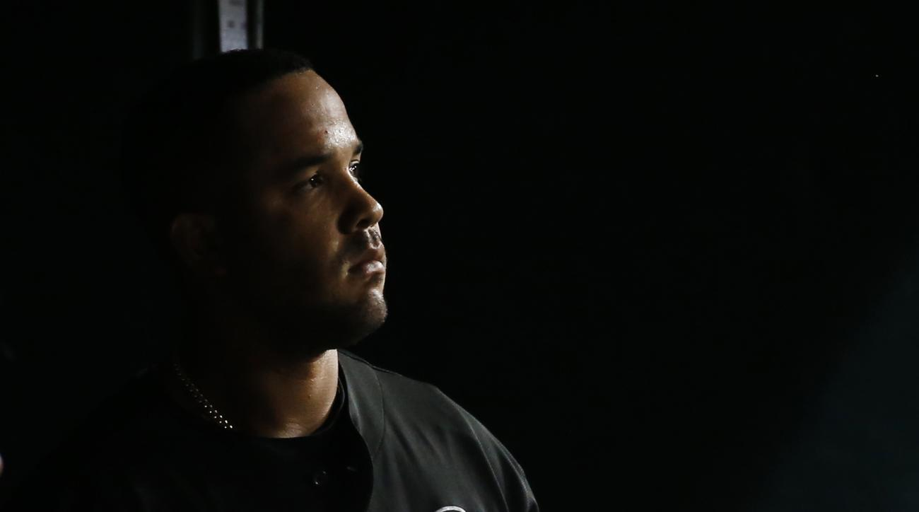 FILE - In this Sept. 22, 2015, file photo, Chicago White Sox's Jose Abreu watches from the dugout against the Detroit Tigers in the fourth inning of a baseball game, in Detroit.  Now in his third season, Abreu will try to help his team rebound from a disa