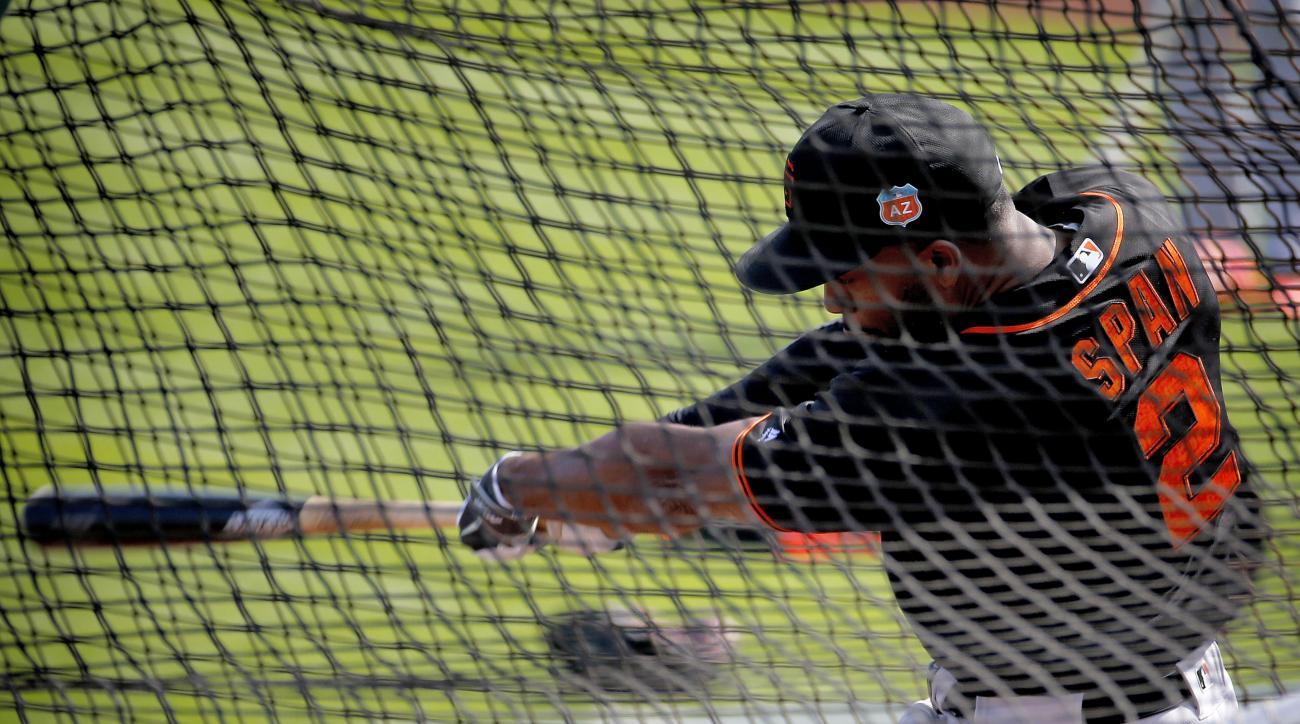 San Francisco Giants' Denard Span hits during spring training baseball practice, Tuesday, Feb. 23, 2016, in Scottsdale, Ariz.  (AP Photo/Matt York)