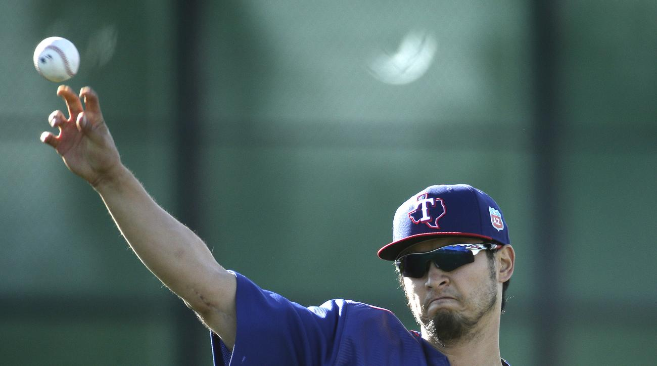 Texas Rangers' pitcher Yu Darvish throws during spring training baseball practice, Tuesday, Feb. 23, 2016, in Surprise, Ariz. (AP Photo/Charlie Riedel)
