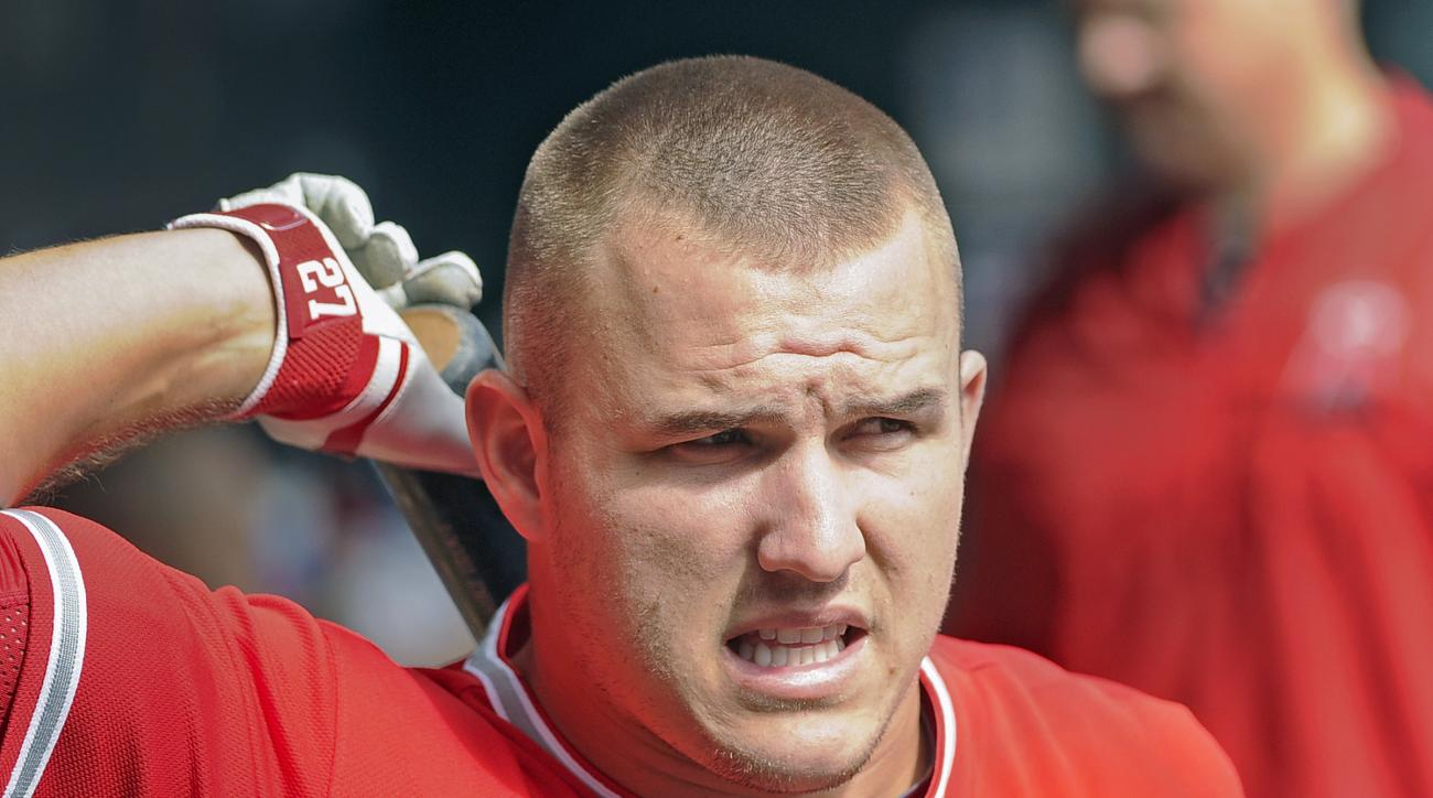 FILE - In this Sept. 20, 201`5, file photo, Los Angeles Angels center fielder Mike Trout gets ready for his first at-bat against the Minnesota Twins in the first inning of a baseball game,  in Minneapolis. Trout still doesn't have a playoff victory during