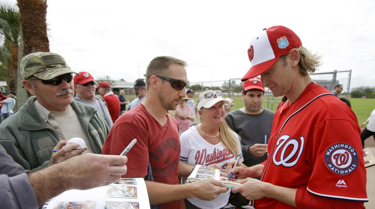 FILE - In this Feb. 20, 2016, file photo, Bronson Arroyo, right, signs autographs for fans during a spring training baseball workout, in Viera, Fla. Bronson Arroyo turns 39 on Wednesday, Feb. 24, 2016, and he hasn't pitched in the majors in nearly two yea