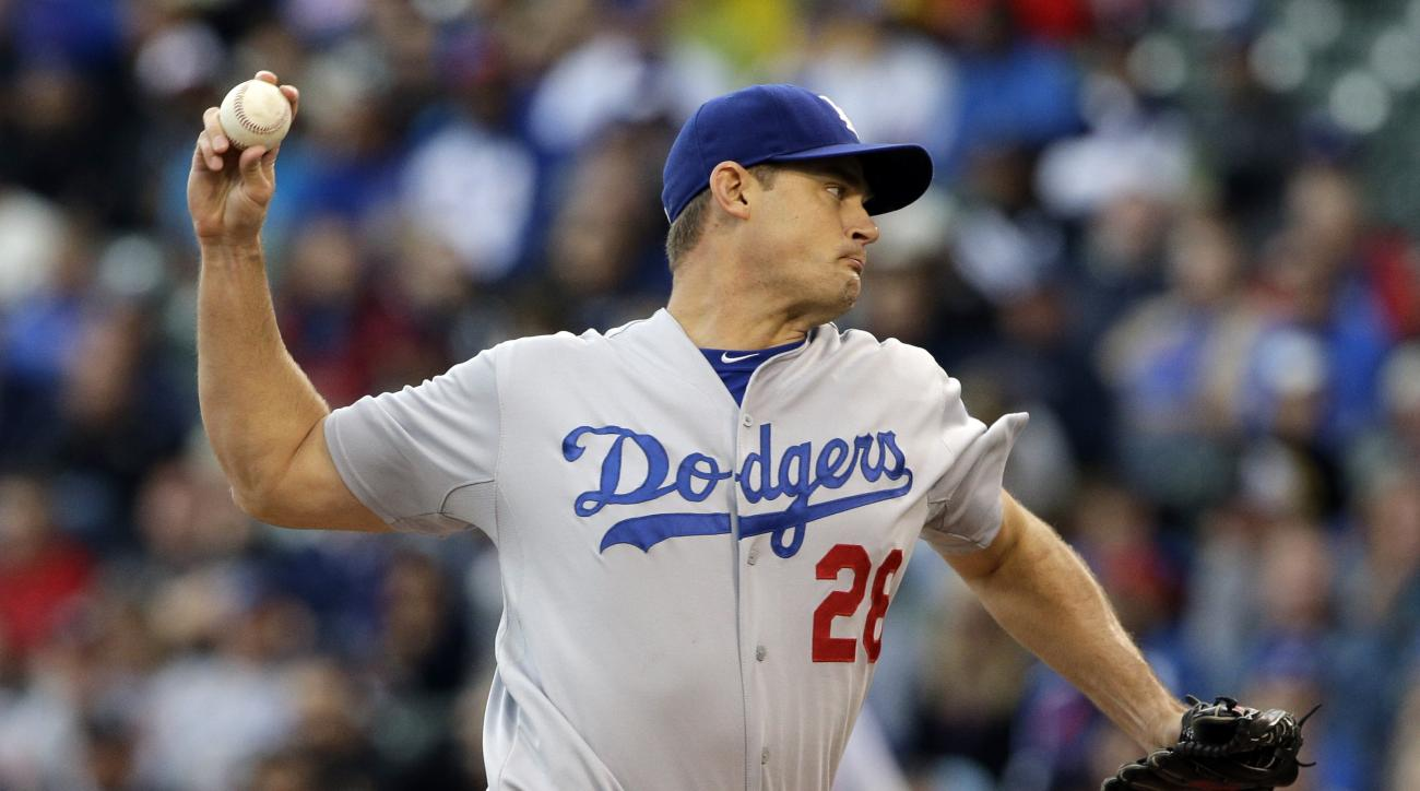 FILE - In this Sept. 21, 2014, file photo, Los Angeles Dodgers pitcher Jamey Wright throws against the Chicago Cubs during the first inning of a baseball game in Chicago. The Dodgers have signed the veteran pitcher to a minor league deal, Wednesday, Feb.