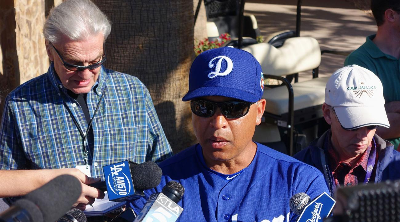 Los Angeles Dodgers manager Dave Roberts speaks with the media prior to a spring training baseball workout Wednesday, Feb. 24, 2016, in Glendale, Ariz. (AP Photo/Ross D. Franklin)