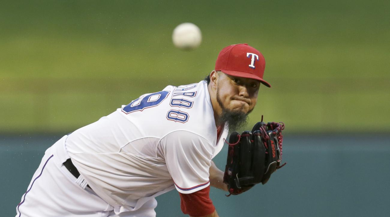 FILE - In this Friday, Sept. 18, 2015 file photo,Texas Rangers starting pitcher Yovani Gallardo throws during the first inning of a baseball game against the Seattle Mariners in Arlington, Texas. The Baltimore Orioles were hopeful Yovani Gallardo would be
