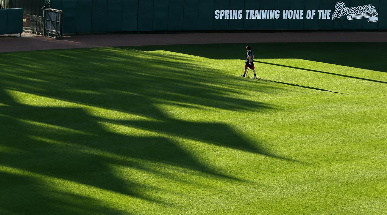 Baseball pennants cast shadows as Atlanta Braves prospect Dansby Swanson walks to the batting cages at baseball spring training in Kissimmee, Fla., early Thursday, Feb. 25, 2016.  (Curtis Compton/Atlanta Journal-Constitution via AP)  MARIETTA DAILY OUT; G