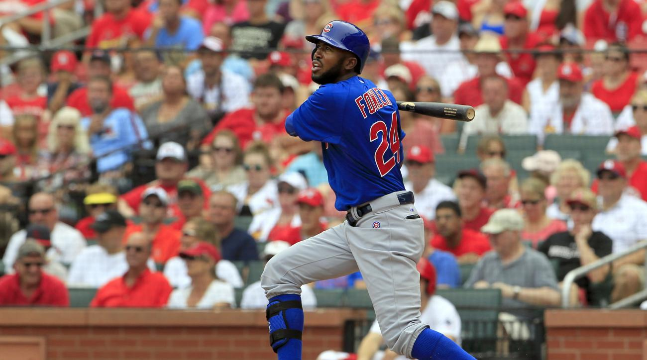 FILE - In this Sept. 7, 2015, file photo, Chicago Cubs' Dexter Fowler watches his two-run double during the second inning of a baseball game against the St. Louis Cardinals, in St. Louis. Fowler agreed to stay with the Chicago Cubs, agreeing to a one-year