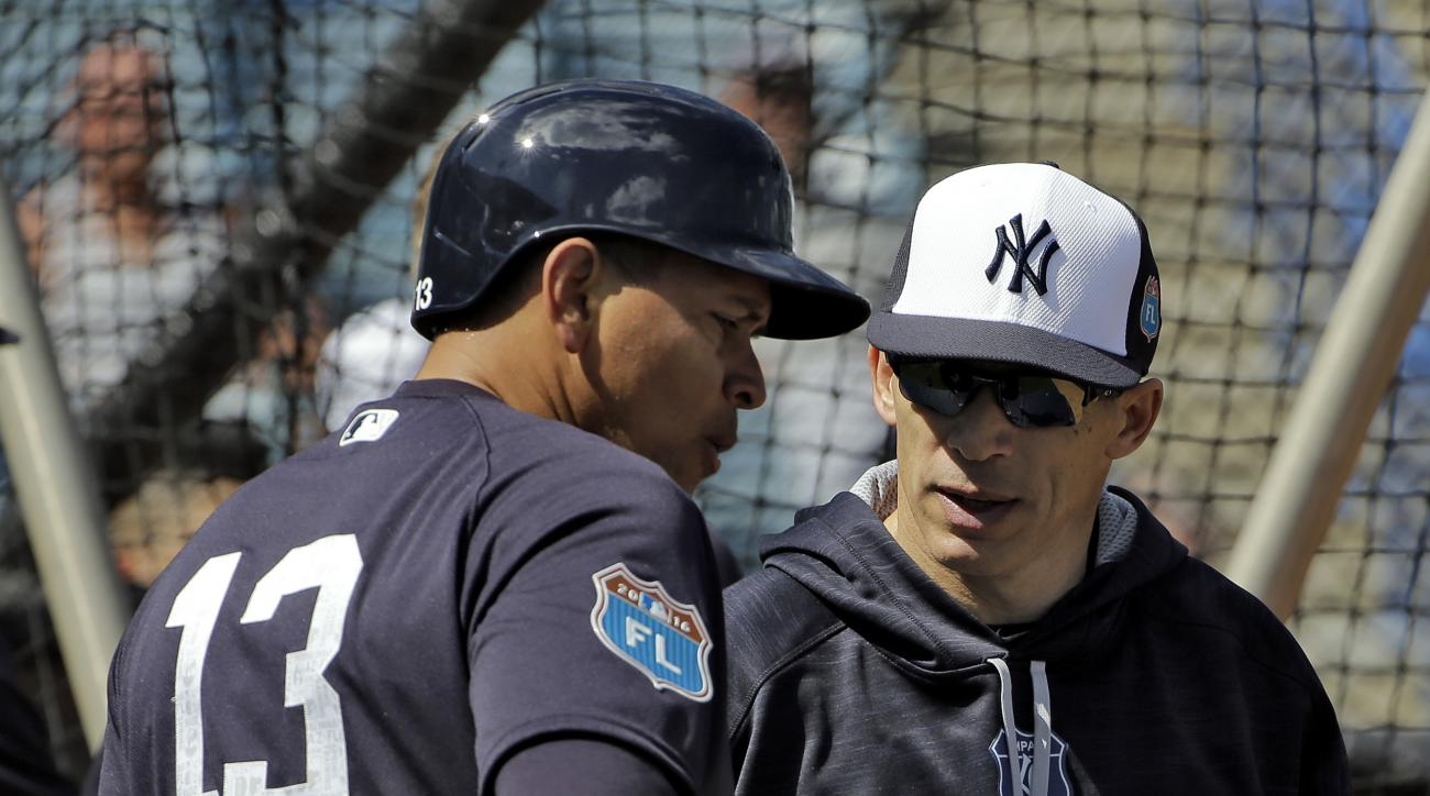 New York Yankees Joe Girardi, right, talks to Alex Rodriguez during a spring training baseball workout Thursday, Feb. 25, 2016, in Tampa, Fla. (AP Photo/Chris O'Meara)