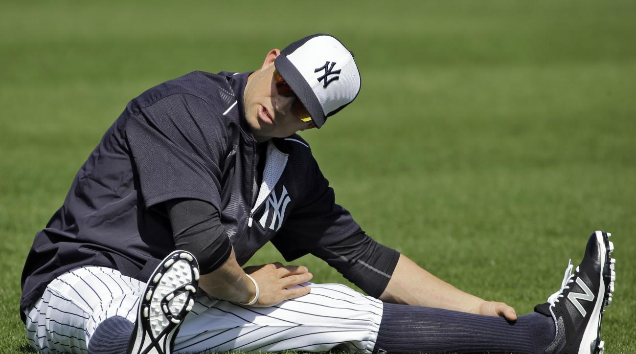 New York Yankees Brett Gardner stretches during a spring training baseball workout Thursday, Feb. 25, 2016, in Tampa, Fla. (AP Photo/Chris O'Meara)