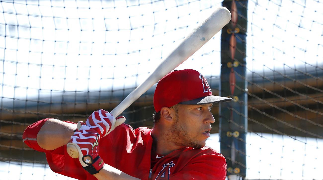 Los Angeles Angels' Andrelton Simmons hits during a spring training baseball practice, Thursday, Feb. 25, 2016, in Tempe, Ariz.  (AP Photo/Matt York)