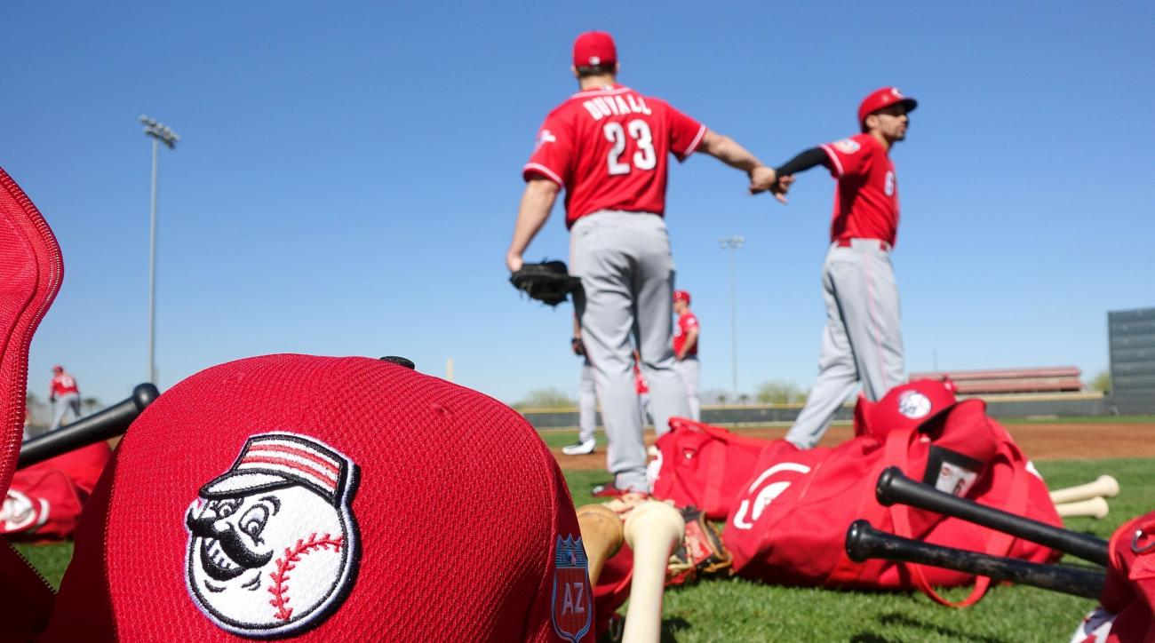 Cincinnati Reds' Adam Duvall (23) and Billy Hamilton (6) fist pump during a spring training baseball workout Thursday, Feb. 25, 2016, in Goodyear, Ariz. (AP Photo/Ross D. Franklin)