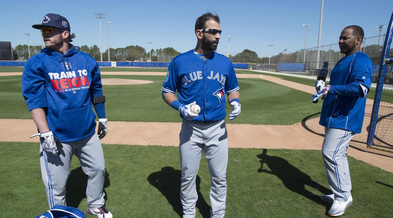 Toronto Blue Jays third baseman Josh Donaldson, left, outfielder Jose Bautista. center, and first baseman Edwin Encarnacion prepare for batting practice during a spring training baseball workout in Dunedin, Fla., Friday, Feb. 26, 2016. (Frank Gunn/The Can