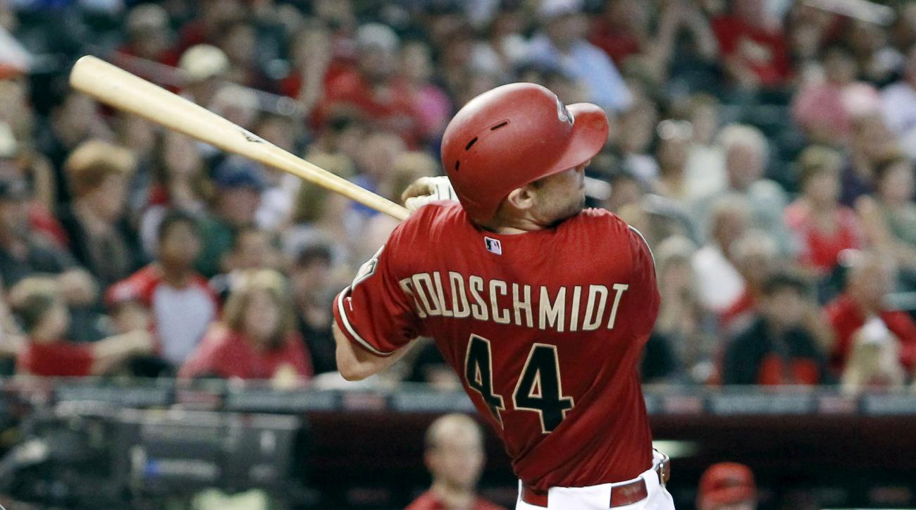 FILE - In this Oct. 4, 2015, file photo, Arizona Diamondbacks' Paul Goldschmidt watches the flight of the ball as he hits a two-run home run against the Houston Astros during the seventh inning of a baseball game, in Phoenix. Goldschmidt, depending on one
