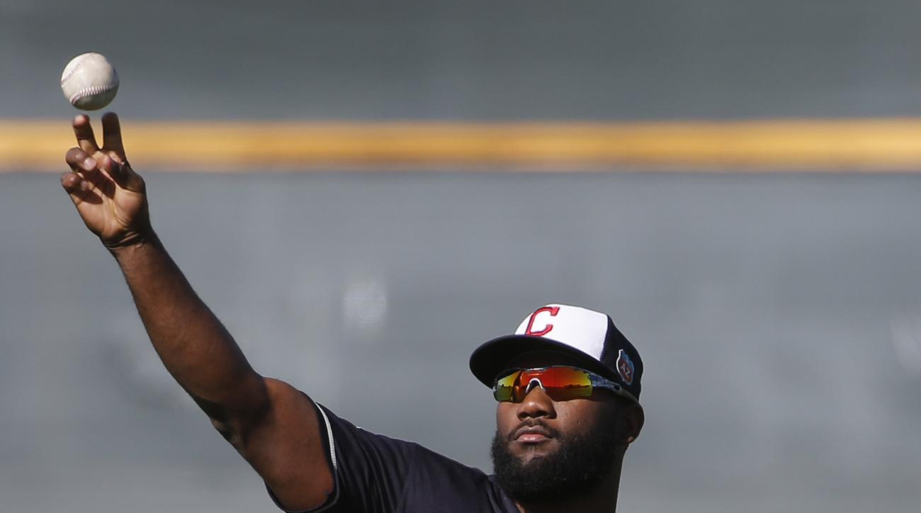 Cleveland Indians' Abraham Almonte warms up during a spring training baseball workout Thursday, Feb. 25, 2016, in Goodyear, Ariz. (AP Photo/Ross D. Franklin)
