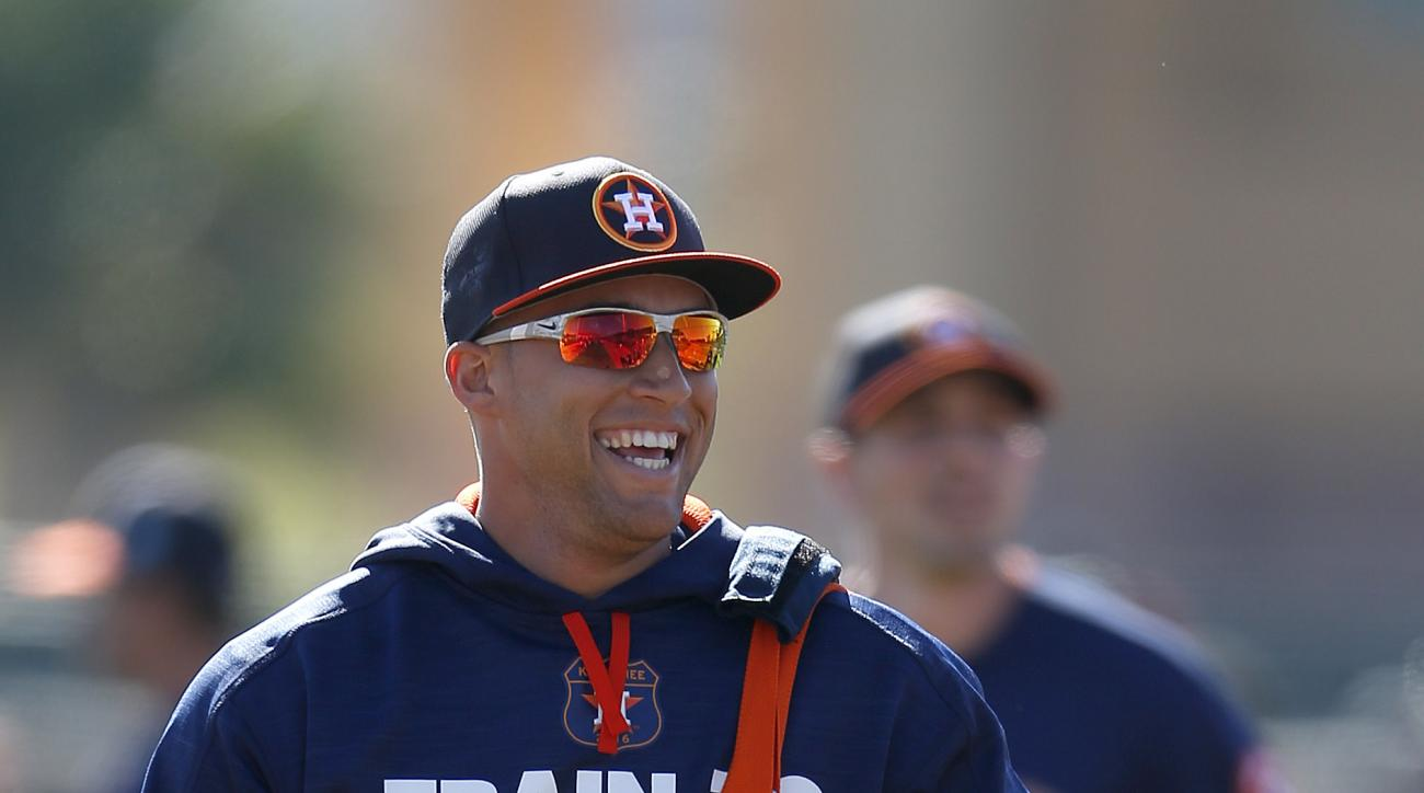 Houston Astros outfielder George Springer laughs after warmups during a spring training baseball workout in Kissimmee, Fla., Friday, Feb. 26, 2016. (Karen Warren/Houston Chronicle via AP) MANDATORY CREDIT
