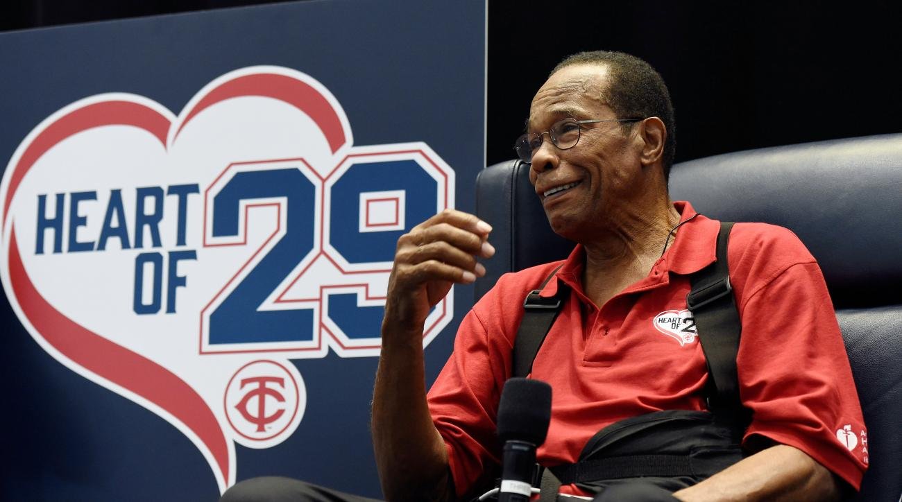FILE - In this Jan. 30, 2016 file photo, Hall of Famer and former Minnesota Twins baseball player Rod Carew speaks to fans about his recent heart attack during TwinsFest in Minneapolis. Carew has reached his goal of attending the Minnesota Twins first ful
