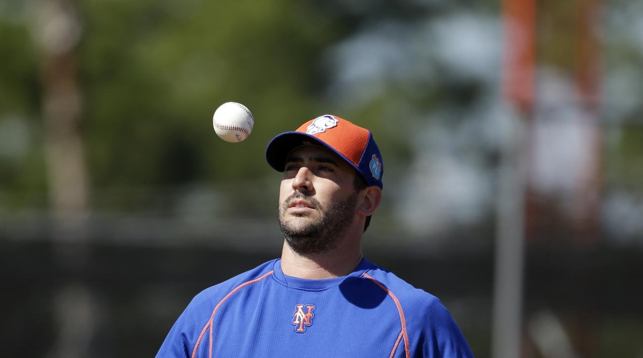 New York Mets pitcher Matt Harvey tosses a ball in the air during a spring training baseball workout Saturday, Feb. 27, 2016, in Port St. Lucie, Fla. (AP Photo/Jeff Roberson)