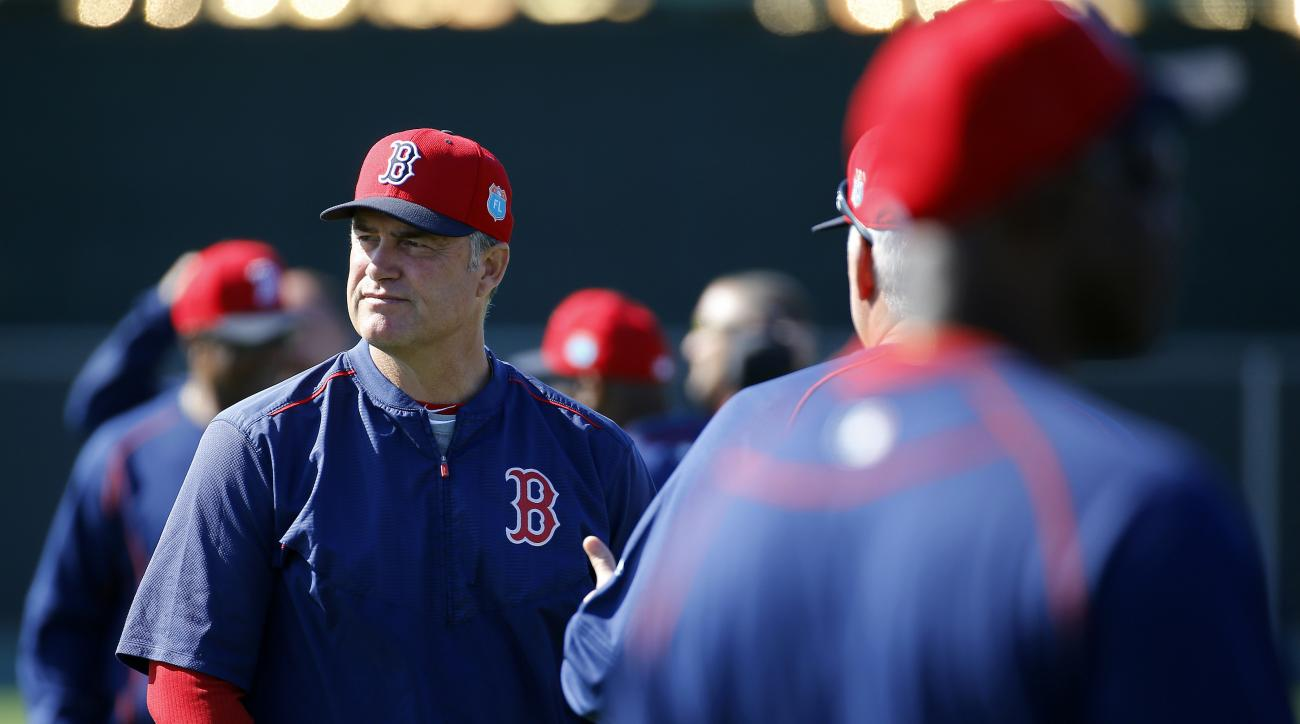 Boston Red Sox manager John Farrell watches players warm up during a spring training baseball workout in Fort Myers, Fla., Sunday, Feb. 28, 2016. (AP Photo/Patrick Semansky)