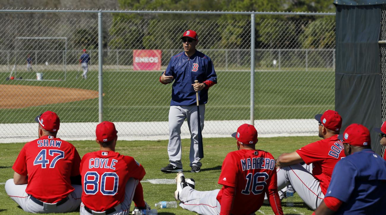 Boston Red Sox first base coach Ruben Amaro Jr., center, speaks with players during a spring training baseball workout in Fort Myers, Fla., Sunday, Feb. 28, 2016. (AP Photo/Patrick Semansky)