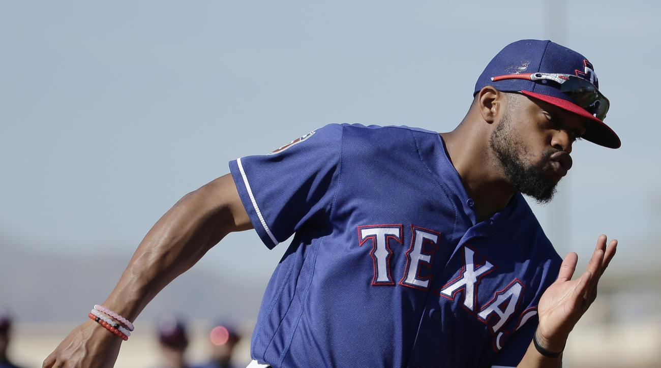 Texas Rangers' Delino DeShields practices running the bases during spring training baseball practice Sunday, Feb. 28, 2016, in Surprise, Ariz. (AP Photo/Charlie Riedel)