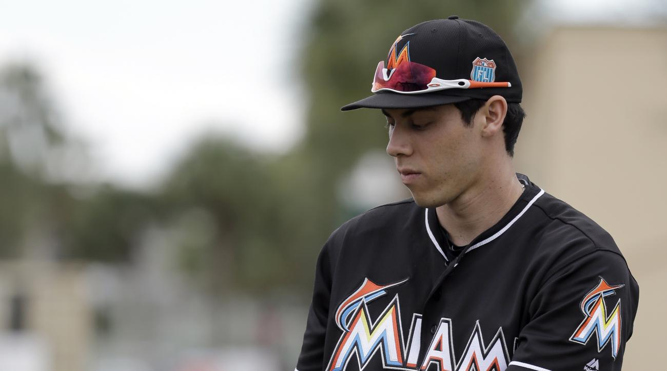 Miami Marlins' Christian Yelich holds a bat during a spring training baseball workout Monday, Feb. 29, 2016, in Jupiter, Fla. (AP Photo/Jeff Roberson)