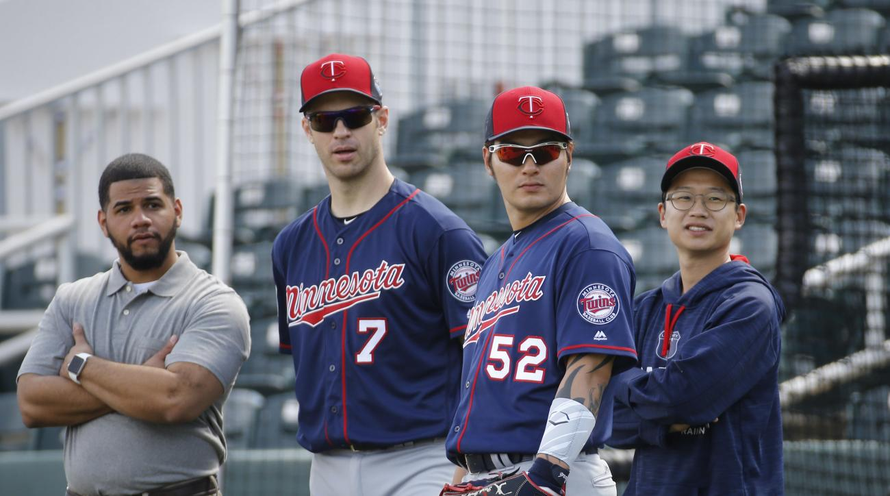 Minnesota Twins first baseman Joe Mauer (7) stands with teammate Byung Ho Park, of South Korea, during a spring training baseball workout in Fort Myers, Fla., Monday, Feb. 29, 2016. (AP Photo/Patrick Semansky)