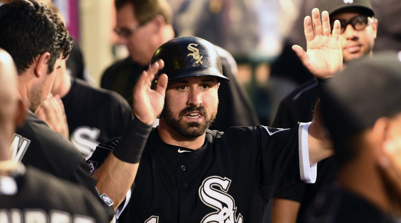 FILE - In this Monday, Aug. 17, 2015 file photo, Chicago White Sox's Adam Eaton, center, celebrates with the dugout after scoring on a fielders choice during the third inning of a baseball game against the Los Angeles Angels in Anaheim, Calif. Eaton apolo
