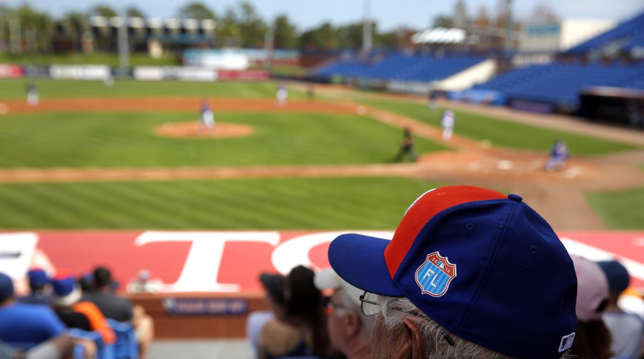 Fans watch as the New York Mets play in an intrasquad baseball game at spring training, Tuesday, March 1, 2016, in Port St. Lucie, Fla. (AP Photo/Jeff Roberson)