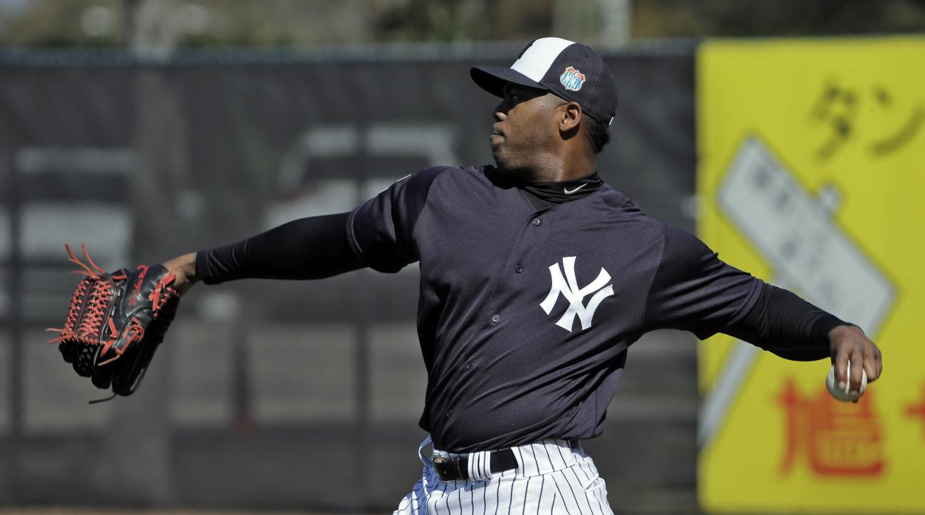 FILE - In this Feb. 19, 2016, file photo, New York Yankees pitcher Aroldis Chapman throws during a spring training baseball workout, in Tampa, Fla. Aroldis Chapman agreed to accept a 30-game suspension under Major League Baseball's domestic violence polic