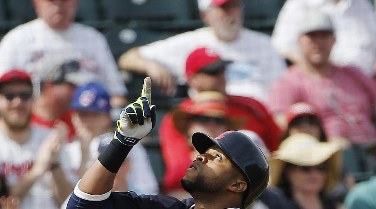 Cleveland Indians' Carlos Santana points to the sky as he arrives at home plate after hitting a home run against the Cincinnati Reds during the second inning of a spring baseball game Tuesday, March 1, 2016, in Goodyear, Ariz. (AP Photo/Ross D. Franklin)