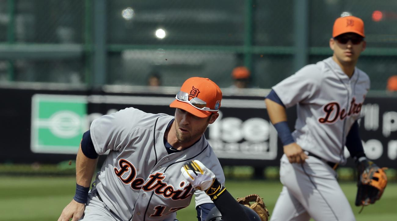 Detroit Tigers second baseman Andrew Romine (17) tags out Pittsburgh Pirates' Andrew McCutchen (22) at second on a stolen base attempt during the first inning of a spring training baseball game Wednesday, March 2, 2016, in Bradenton, Fla. Backing up the p