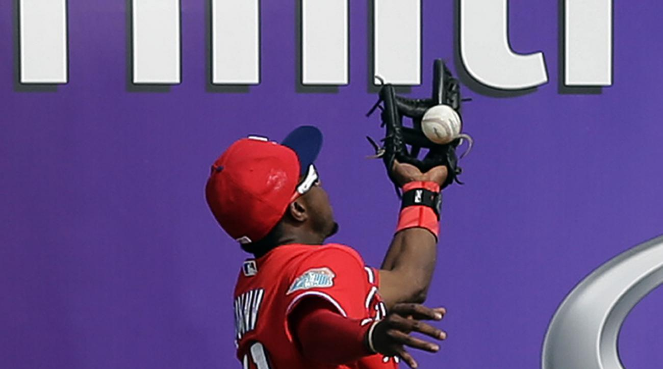 Philadelphia Phillies center fielder Roman Quinn makes a catch on a fly out by New York Yankees' Chase Headley during the sixth inning of a spring training baseball game Thursday, March 3, 2016, in Tampa, Fla. (AP Photo/Chris O'Meara)
