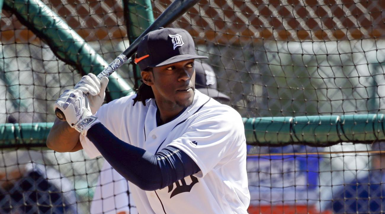 FILE - In this Feb. 27, 2016, file photo, Detroit Tigers' Cameron Maybin takes batting practice during a spring training baseball workout in Lakeland, Fla. Maybin is likely to miss the start of the season because of a broken left wrist. (AP Photo/John Rao
