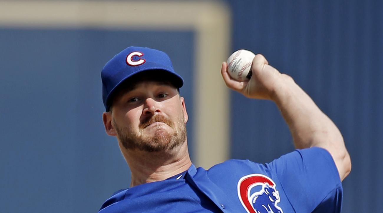 Chicago Cubs' Travis Wood warms up for a spring training baseball game against the Milwaukee Brewers on Thursday, March 3, 2016, in Phoenix. (AP Photo/Morry Gash)