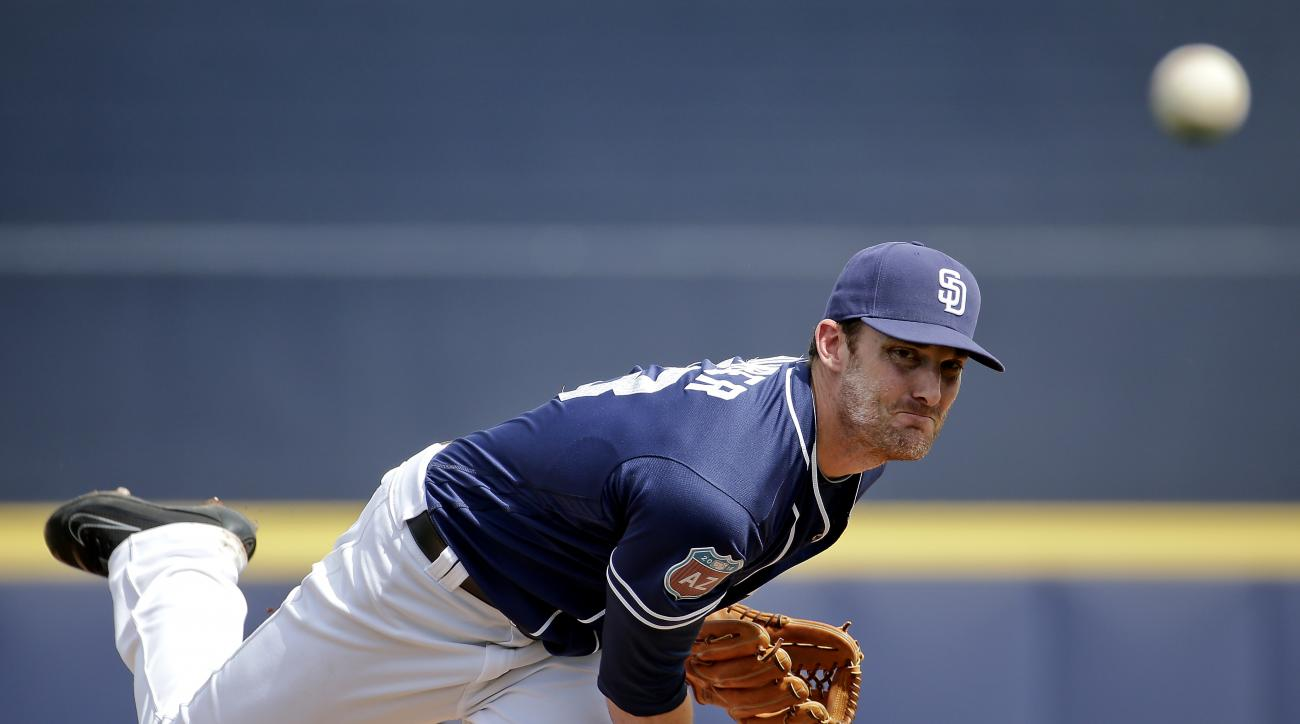 San Diego Padres starting pitcher Philip Humber throws during the first inning of a spring training baseball game against the Seattle Mariners, Thursday, March 3, 2016, in Peoria, Ariz. (AP Photo/Charlie Riedel)
