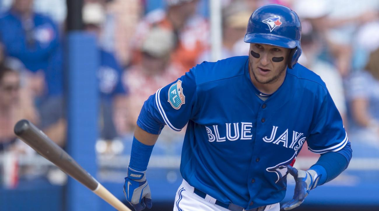 Toronto Blue Jays' Troy Tulowitzki throws his bat as he gets walked during the first inning of a baseball spring training game against the Baltimore Orioles in Dunedin, Fla., Friday, March 4, 2016. (Frank Gunn/The Canadian Press via AP) MANDATORY CREDIT
