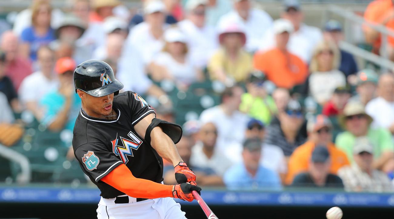 Miami Marlins right fielder Giancarlo Stanton flies out during the second inning of a spring training baseball game against the Washington Nationals Friday, March 4, 2016, at Roger Dean Stadium in Jupiter, Fla. (David Santiago/El Nuevo Herald via AP)  MAG