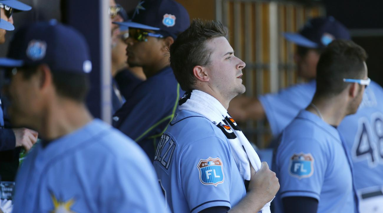 Tampa Bay Rays starting pitcher Jake Odorizzi, center, stands in the dugout after being relieved in the second inning of a spring training baseball game against the Minnesota Twins in Port Charlotte, Fla., Sunday, March 6, 2016. (AP Photo/Patrick Semansky