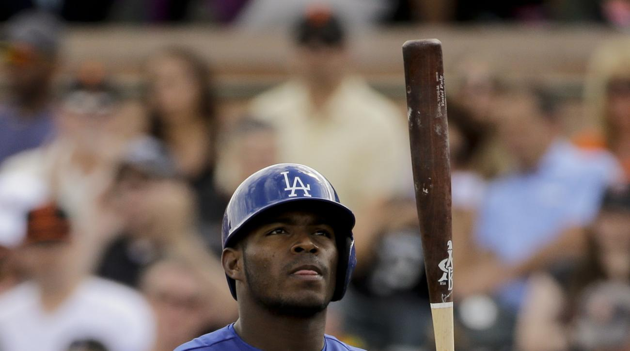 Los Angeles Dodgers' Yasiel Puig tosses his bat after striking out against the San Francisco Giants during third inning of a spring baseball game in Scottsdale, Ariz., Sunday, March 6, 2016. (AP Photo/Chris Carlson)