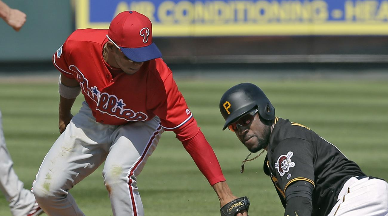 Pittsburgh Pirates' Starling Marte, right, steals second ahead of the tag by Philadelphia Phillies second baseman Cesar Hernandez during the fourth inning of a spring training baseball game Monday, March 7, 2016, in Tampa, Fla. (AP Photo/Chris O'Meara)