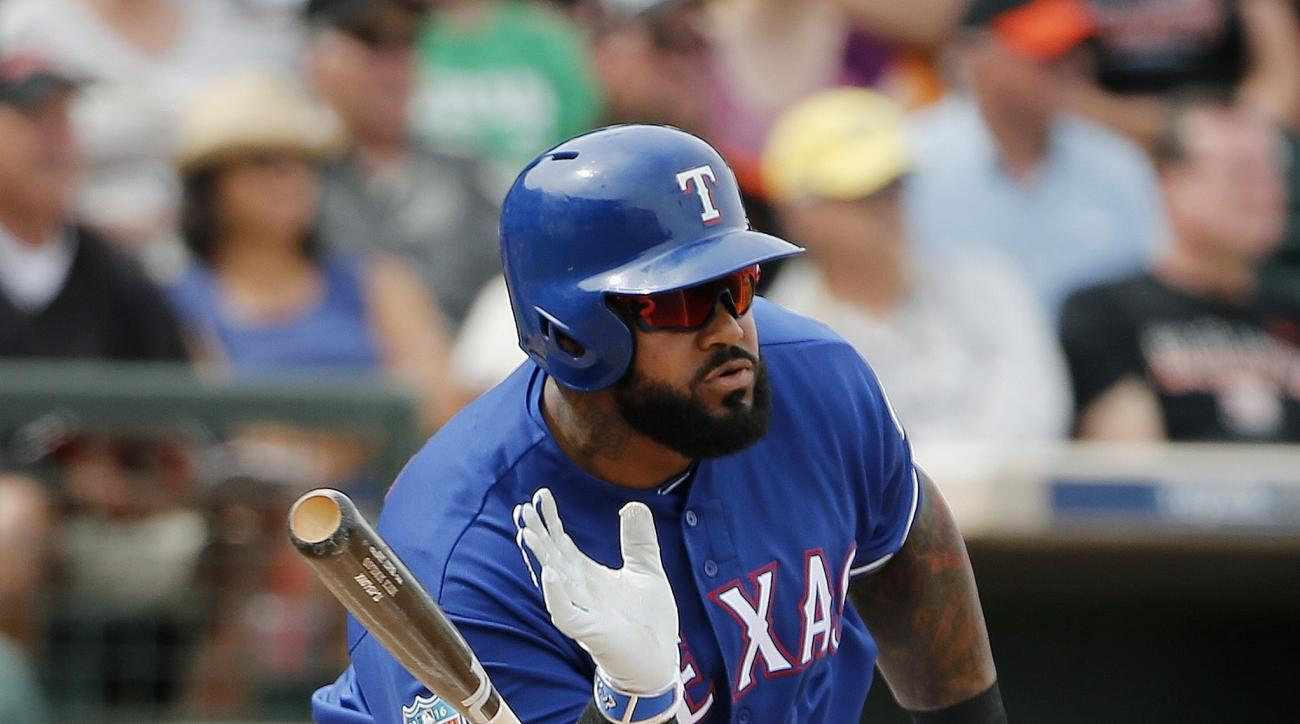 Texas Rangers' Prince Fielder flips the bat away after connecting for a single against the San Francisco Giants during the third inning of a spring training baseball game Monday, March 7, 2016, in Surprise, Ariz. (AP Photo/Ross D. Franklin)