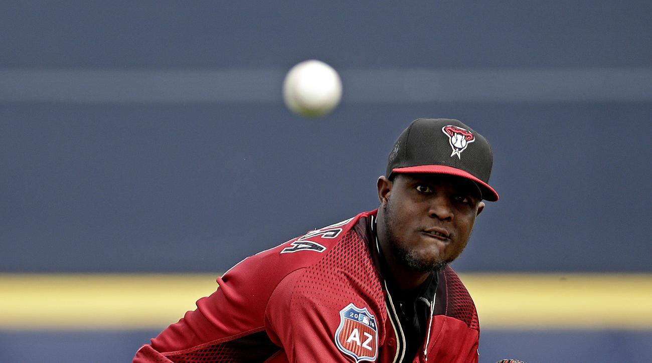 Arizona Diamondbacks starting pitcher Rubby De La Rosa throws during the first inning of a spring training baseball game against the Seattle Mariners Monday, March 7, 2016, in Peoria, Ariz. (AP Photo/Charlie Riedel)