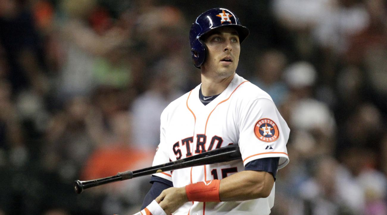 FILE - In this Aug. 17, 2015, file photo, Houston Astros Jason Castro walks to the dugout after striking out in the sixth inning of a baseball game against the Tampa Bay Rays in Houston. Jason Castro helped Houston's pitching staff become one of the most