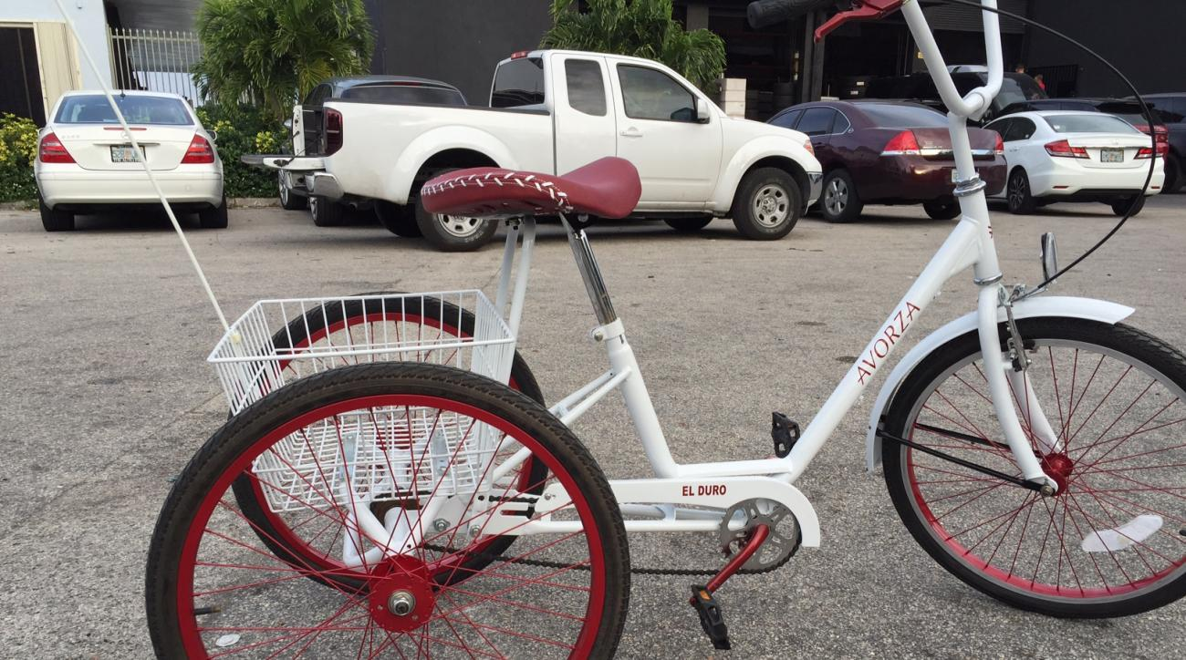 In this March 7, 2016, photo provided by Alex Vega, a custom made three-wheel bicycle is shown outside The Auto Firm in Doral, Fla. Yoenis Cespedes' newest custom ride is a definite throwback. The New York Mets outfielder, whose car collection drew headli