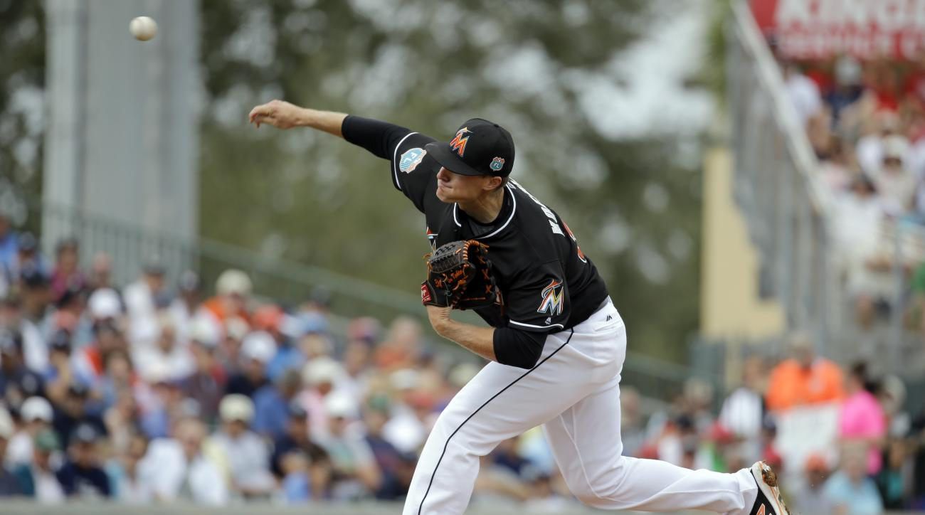 Miami Marlins starting pitcher Tom Koehler throws during the first inning of an exhibition spring training baseball game against the New York Yankees Tuesday, March 8, 2016, in Jupiter, Fla. (AP Photo/Jeff Roberson)