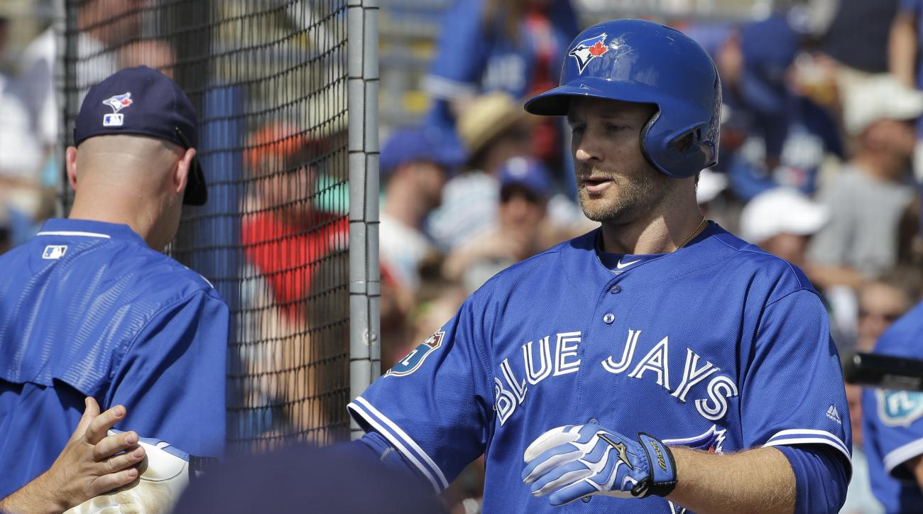 Toronto Blue Jays' David Adams celebrates with teammates after hitting a home run off Minnesota Twins pitcher Pat Dean during the fifth inning of a spring training baseball game Tuesday, March 8, 2016, in Dunedin, Fla. (AP Photo/Chris O'Meara)